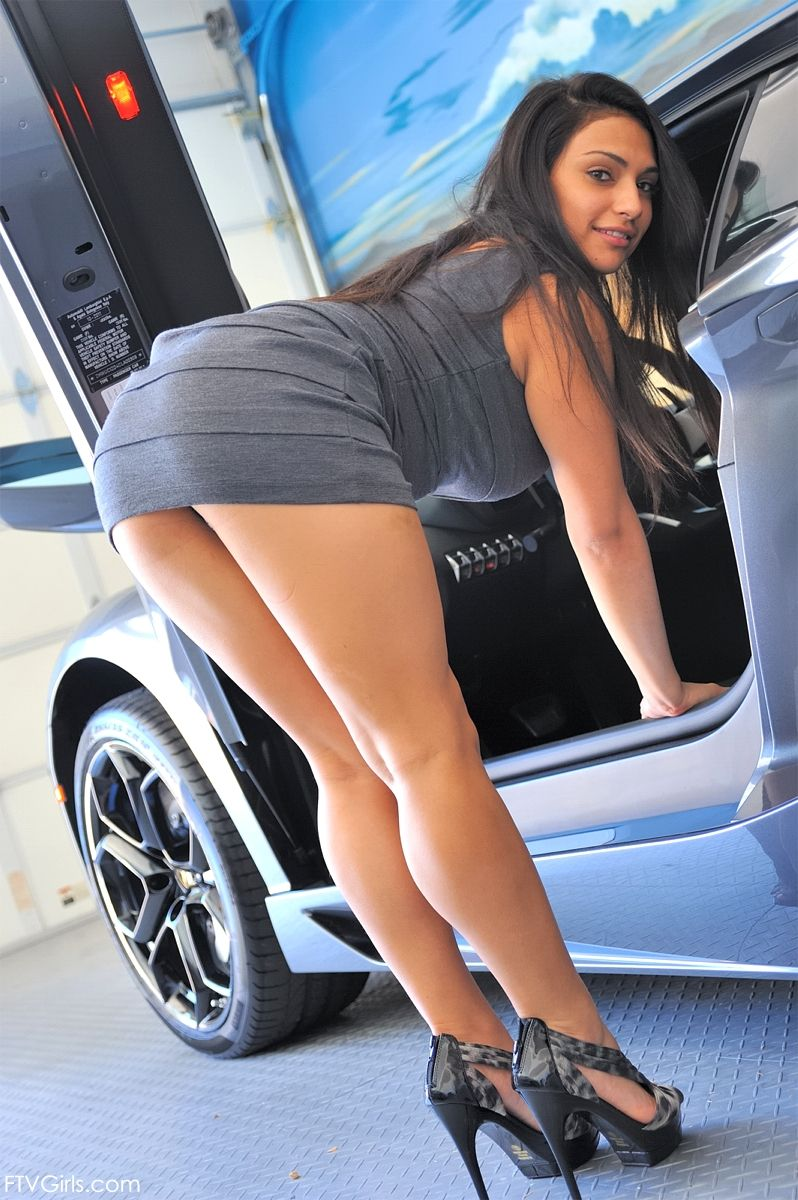 Naked woman in short skirts bent over