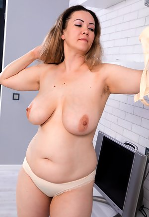 Old milf on bed naked touching her pussy